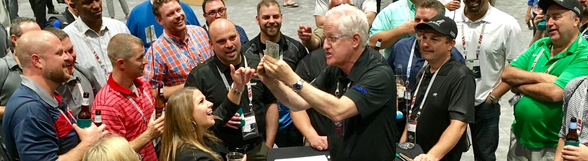 Crowds pack around Corporate Magic at the trade show