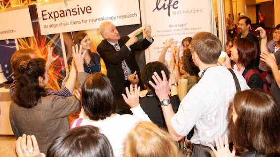 trade show booth magician entertains